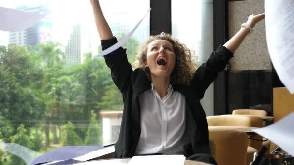 Happy Successful Business Woman With Arms Up Throwing Papers