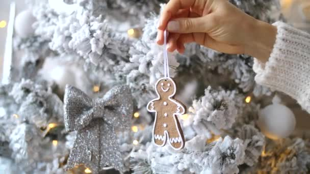 Female Hand Holding Gingerbread Man Cookie. Christmas Decorations For Xmas Tree.