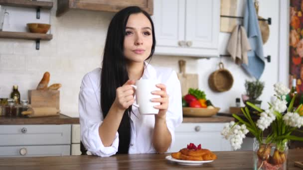 Young Girl With Cup Of Coffee Or Tea Relaxing On Kitchen At Home.