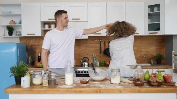Happy Family Couple Dancing In Kitchen Celebrating Good Morning Full Of Positive Emotions.
