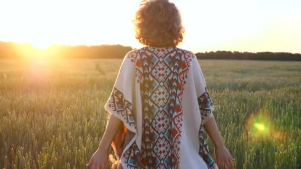 Beautiful Young Woman Walking In A Wheat Field At Sunset