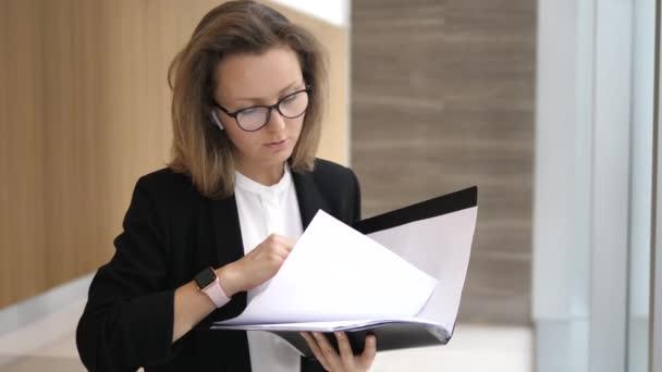 Business Woman In Wireless Earphones Talking On Smartphone