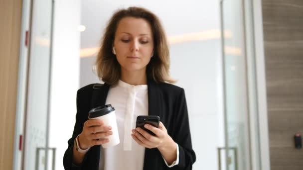 Business Woman Using Phone On Coffee Break