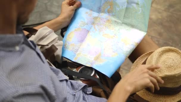 Male Hipster Traveler Reading Map While Sightseeing In City