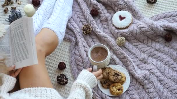 Female Legs In Knitted Socks, Book And Hot Chocolate