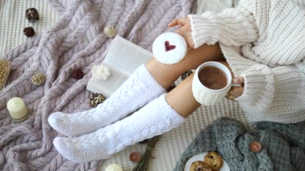 Morning, Coziness, Fall, Winter And People Concept - Woman Legs In Knit Socks