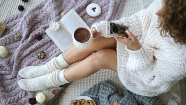 Blogger Taking Pictures With Smartphone Of Legs In Knit Socks And Hot Chocolate