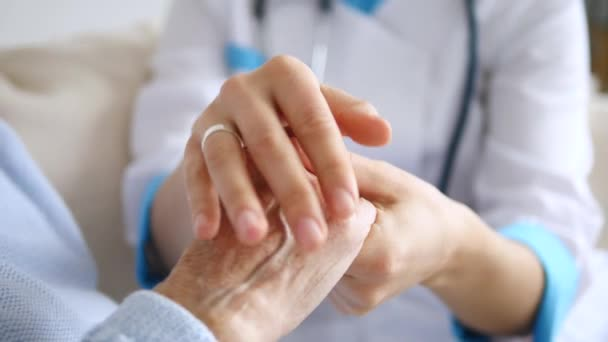 Closeup Of Doctor Keeping Hand Of Senior Patient