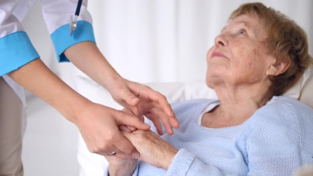 Doctor Reassuring Senior Patient Holding Hands. Elderly Health Care.