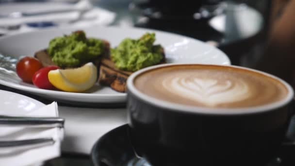 Closeup On Coffee Latte And Avocado Toasts For Breakfast
