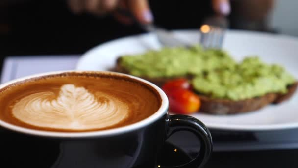Woman Having Tasty Healthy Breakfast: Avocado Toast And Coffee.