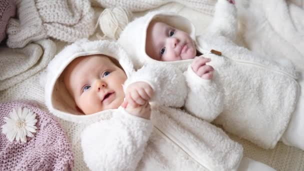 Happy Funny Baby Twins Lying On Knit Blankets At Home.