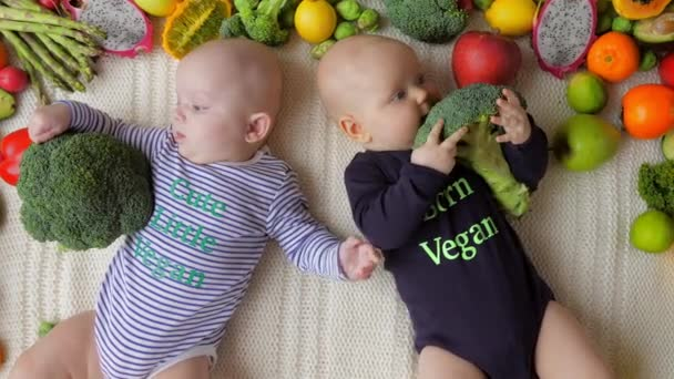 Vegan Twin Babies Eating Broccoli.