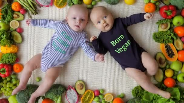 Healthy Babies Born Vegan Lying Together In Organic Fresh Vegetables And Fruits.