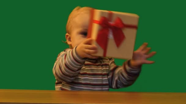 cute 1 year baby with gift box in table green screen
