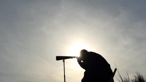 man with spyglass outdoors profile silhouette