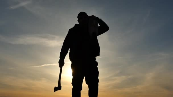 man with axe and dog on shoulder silhouette slow motion in empty place