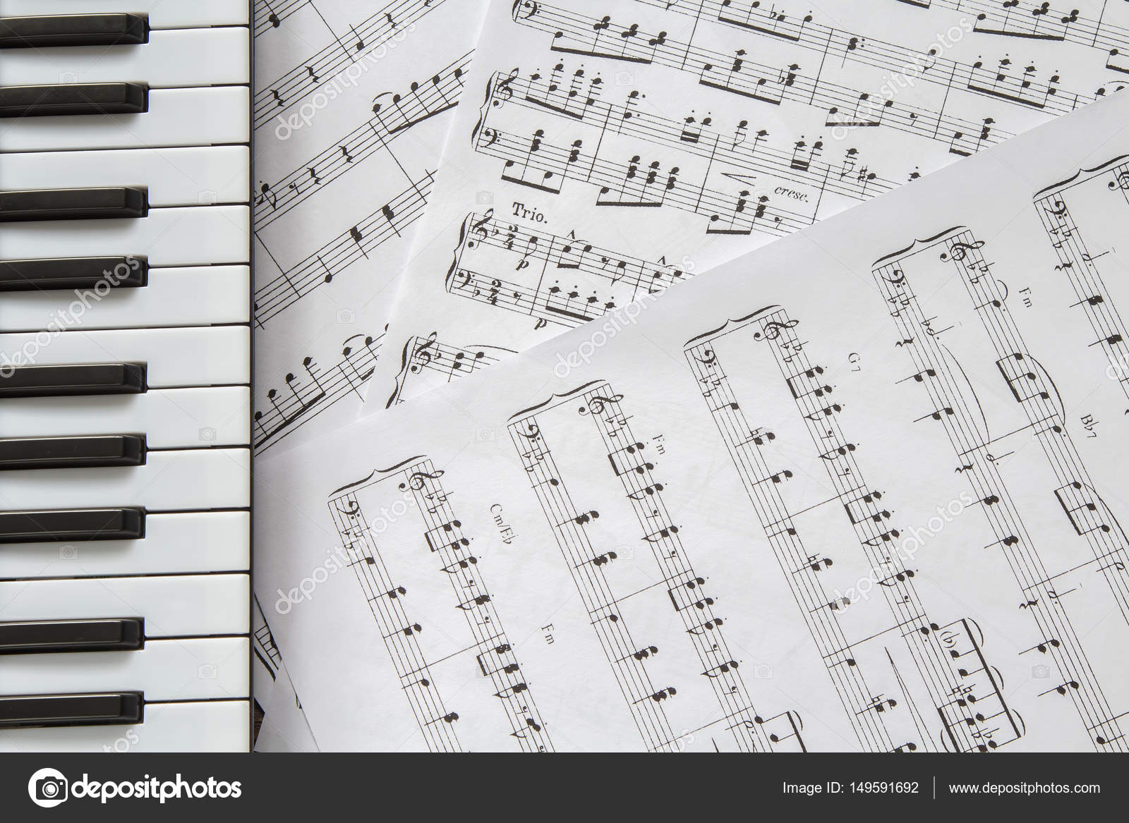 Piano keyboard on music notes background stock photo cyndykids piano keyboard on music notes background stock photo malvernweather Image collections