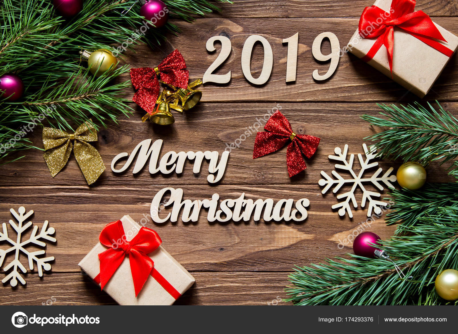 2019 Christmas Gifts Merry Christmas 2019. Christmas gifts and tinsel on the wooden