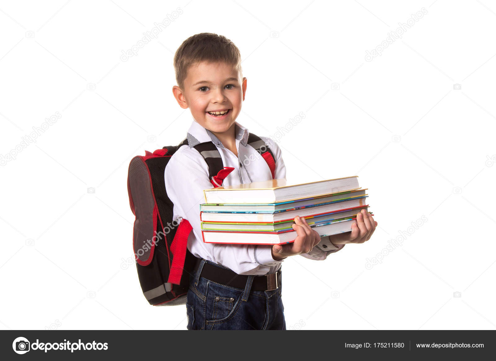 96b83f858a58 Smiling school boy with backpack holding notebooks