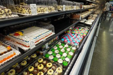 Orlando, FL/USA - 09/17/19:Boxes of cakes and cupcakes baked fresh at a grocery store.