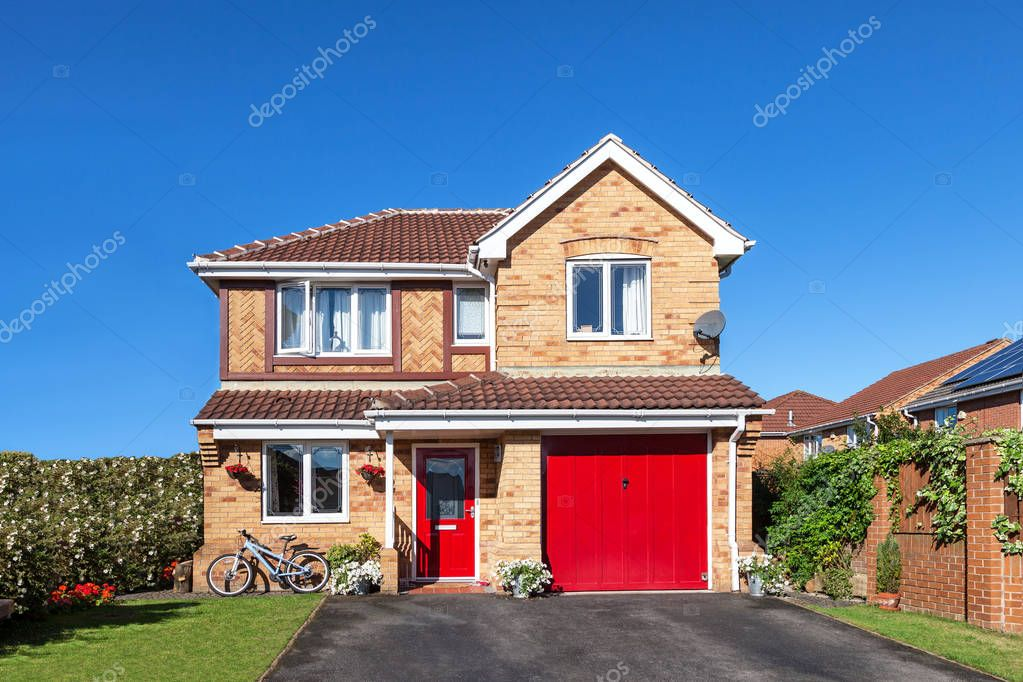 English house with red door