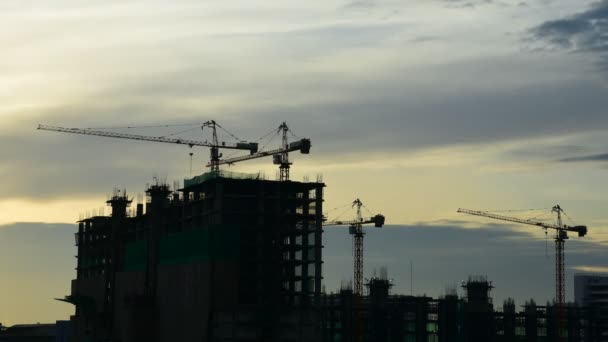 Silhouette of Construction crane with sunrise sky, Timelapse