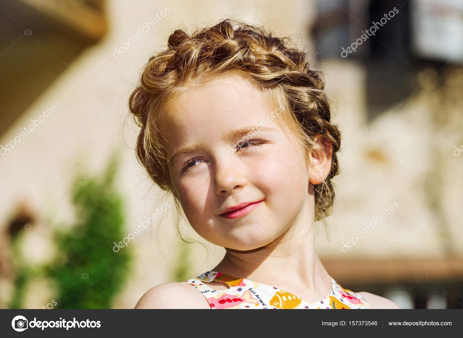 8b282f09c457 Cute little preschooler girl natural portrait on the sun– stock image