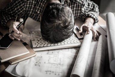 tired engineer lying and sleeping on blueprint with dark retro s