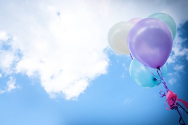 vintage balloon with colorful on blue sky concept of love in sum