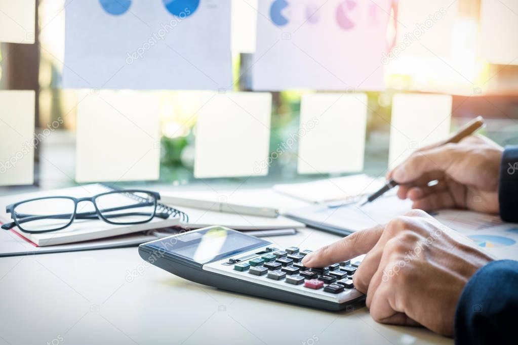 Business finance man calculating budget numbers, Invoices and fi