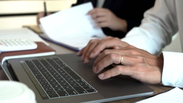4k video of  business man financial inspector and secretary making report, calculating or checking balance. Internal Revenue Service inspector checking document. Audit concept