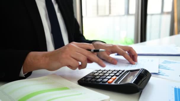 4k video of business man hand using calculator calculating financial expense cost at home office, finance accounting concept