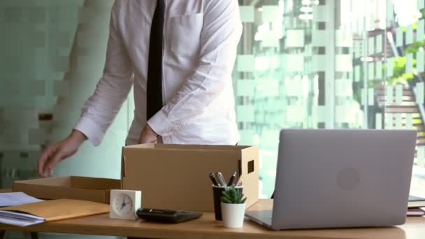 4k video of businessman has a brown cardboard box for resigning from work or unemployment and change job concept