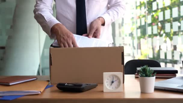 4k video of elegant attractive business man packing personal company belongings resigning from his job changing work in future, Unemployed Business person concept