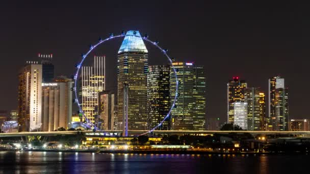 Singapore city, Singapore-  4 August 2019: 4K night time lapse video of amazing beautiful Singapore Flyer marina bay with beautiful cityscape of Central business district