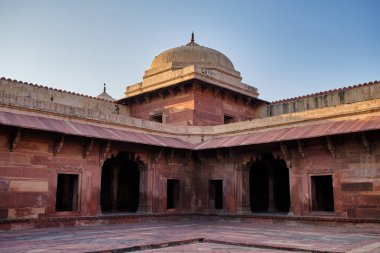 Old red sandstone palace at the Mughal city of Fatehpur Sikri in Agra, Uttar Pradesh, India