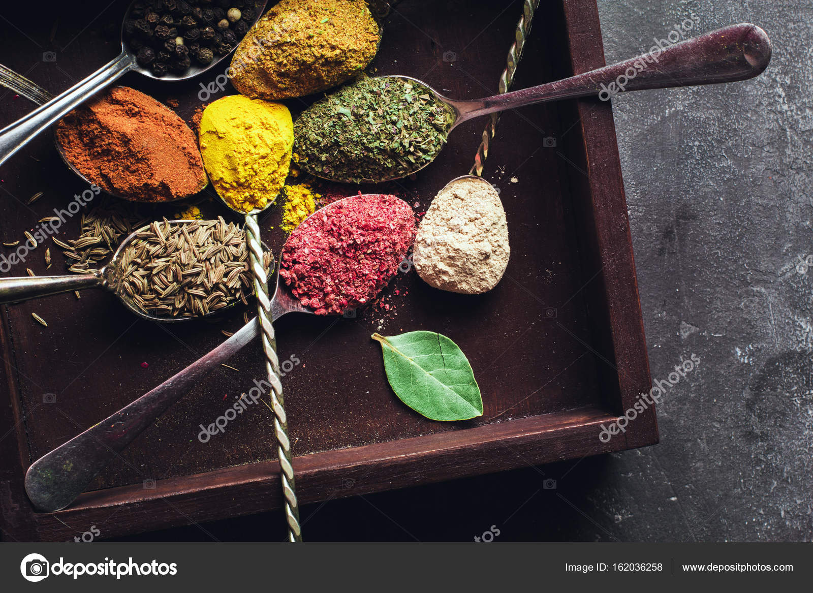 Beautiful Colored Spices In A Silver Spoon On A Dark Background The