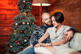 Beautiful couple  with Christmas tree.