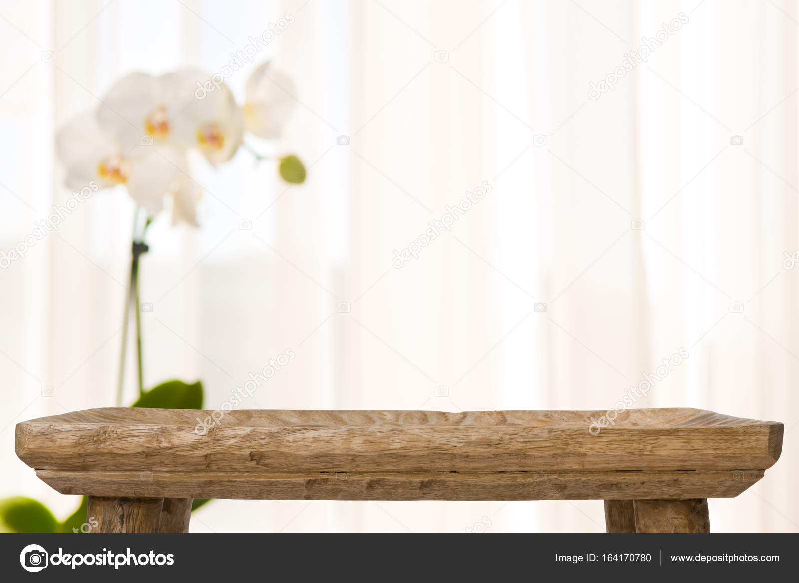 Wooden Bathroom Table On Abstract Blurred Background With Orchid Flower Stock Photo
