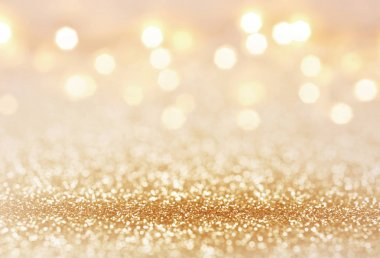 Golden color abstract glitter texture background for holidays