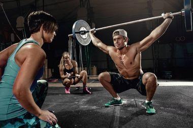 man cross strongman training - snatch workout