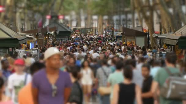Crowded Les Rambles Boulevard in Downtown Barcelona Blurred.  Tourists crowd in Barcelona. Crowds of tourists in Barcelona. Tourists walking in Barcelona in Summer. Crowded Les Rambles boulevard. Crowds of people walking on the street.