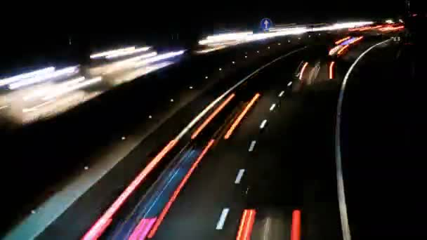 Highway Traffic Cars at Night Time Lapse. Highway with heavy traffic at rush hour. Lots of traffic at night. Cars driving at high speed. Gorgeous, high-energy roads time lapse. Good for a video background. Great for any driving, corporate, city.