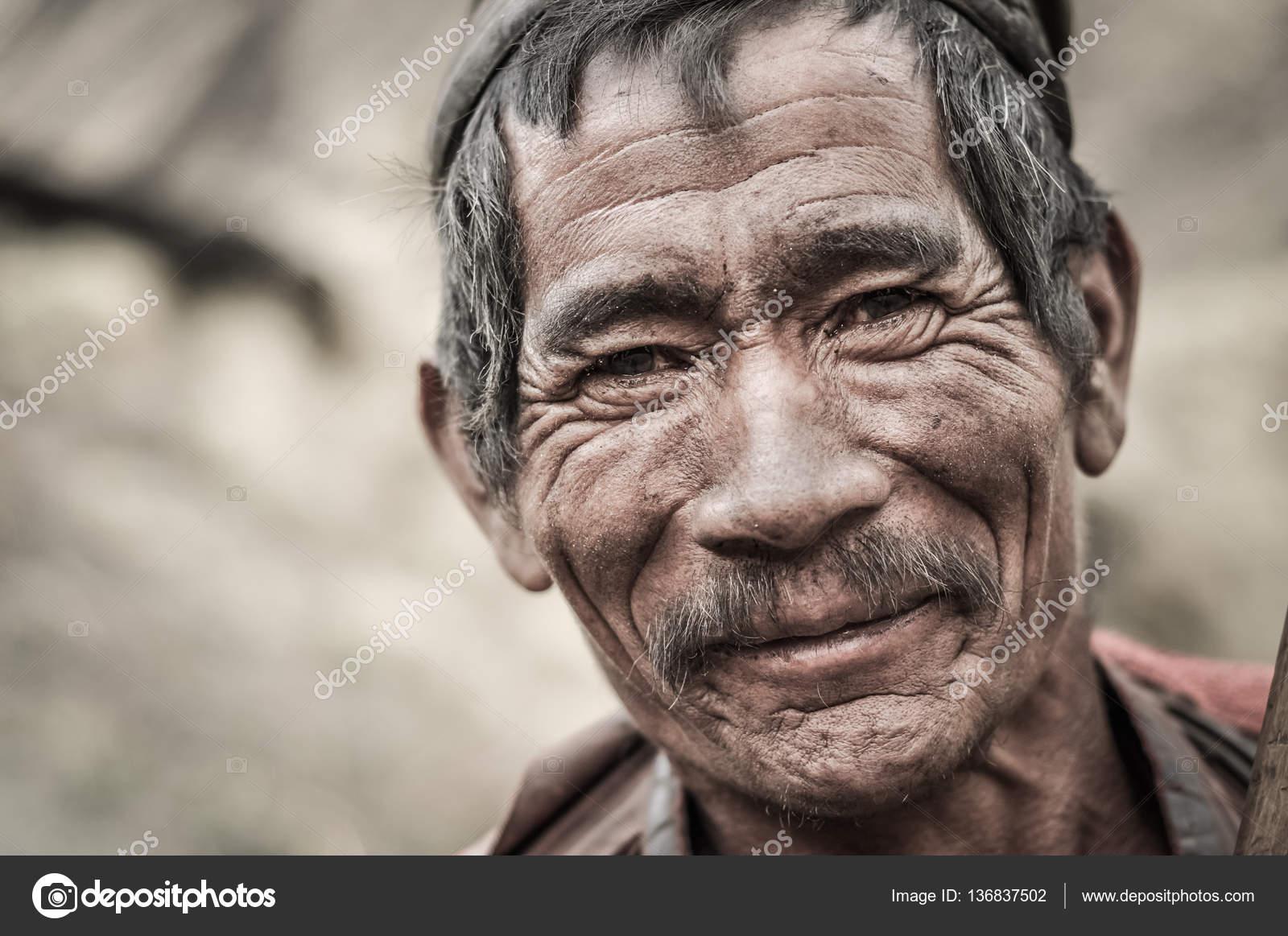 smiling old man in nepal stock editorial photo michalknitl