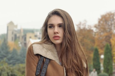 Close-up portrait of a beautiful girl with long brown hair