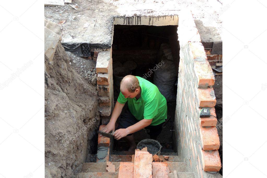 man puts a brick