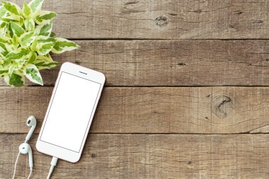 phone blank white screen on old wood table, mockup phone rose go