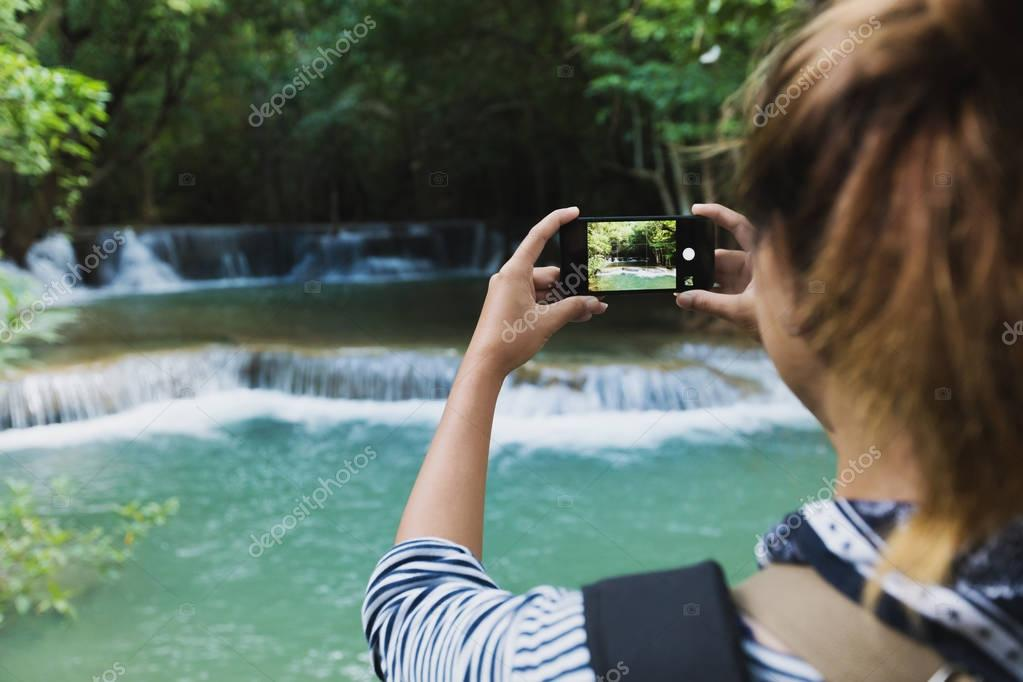 tourism use smartphone taking photograph