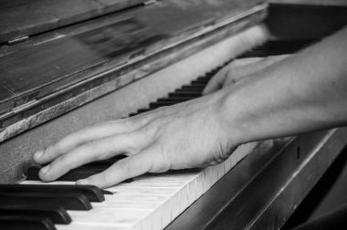 hands of pianist on piano keys